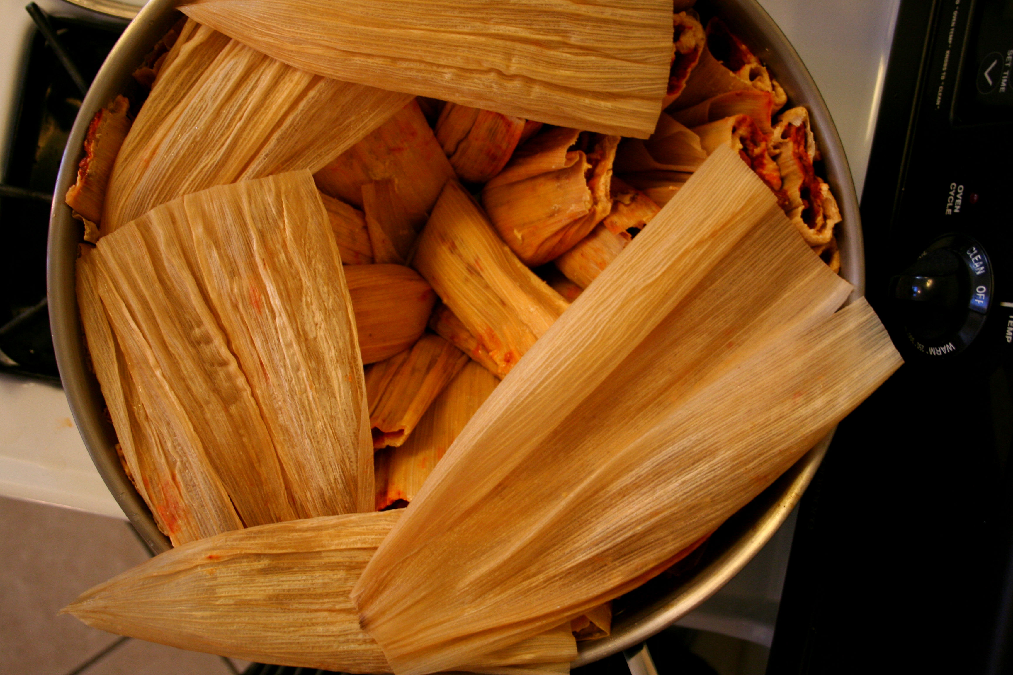 Tamales covered in husks
