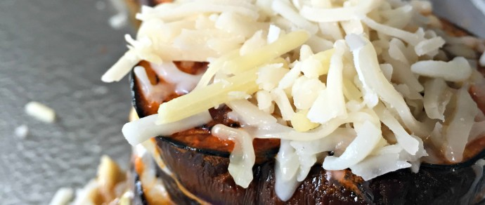 STACKED, CHEESY EGGPLANT WITH ENCHILADA SAUCE