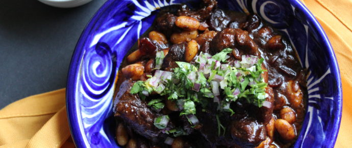 Braised  Oxtail  with  Cannellini  Beans  and  Cherries  with  Cilantro  Gremolata